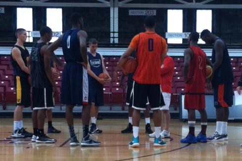 The East Coast All Stars huddle at the start of Saturday's practice. From left: Jarrod Uthoff (Iowa), Jabrille Williams (Binghamton), Phillip Nolan (UConn), Michael Rudy (Lycoming), Mike Gbinije (Syracuse), Russ Smith (Louisville), Rakeem Christmas (Syracuse)